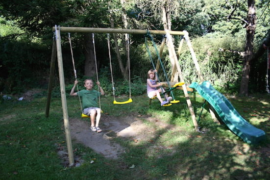 kids on garden swing